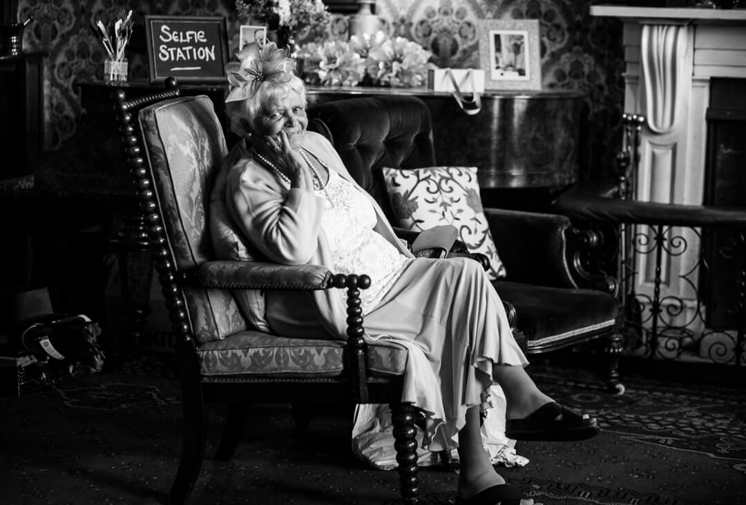 Granny relaxing in chair at Homme House wedding