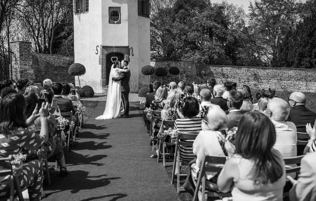 Black and white photo of wedding ceremony in Herefordshire
