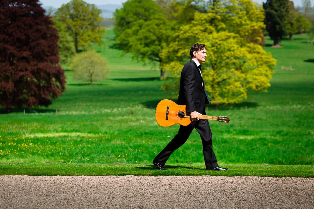 Musician with guitar at Homme House wedding