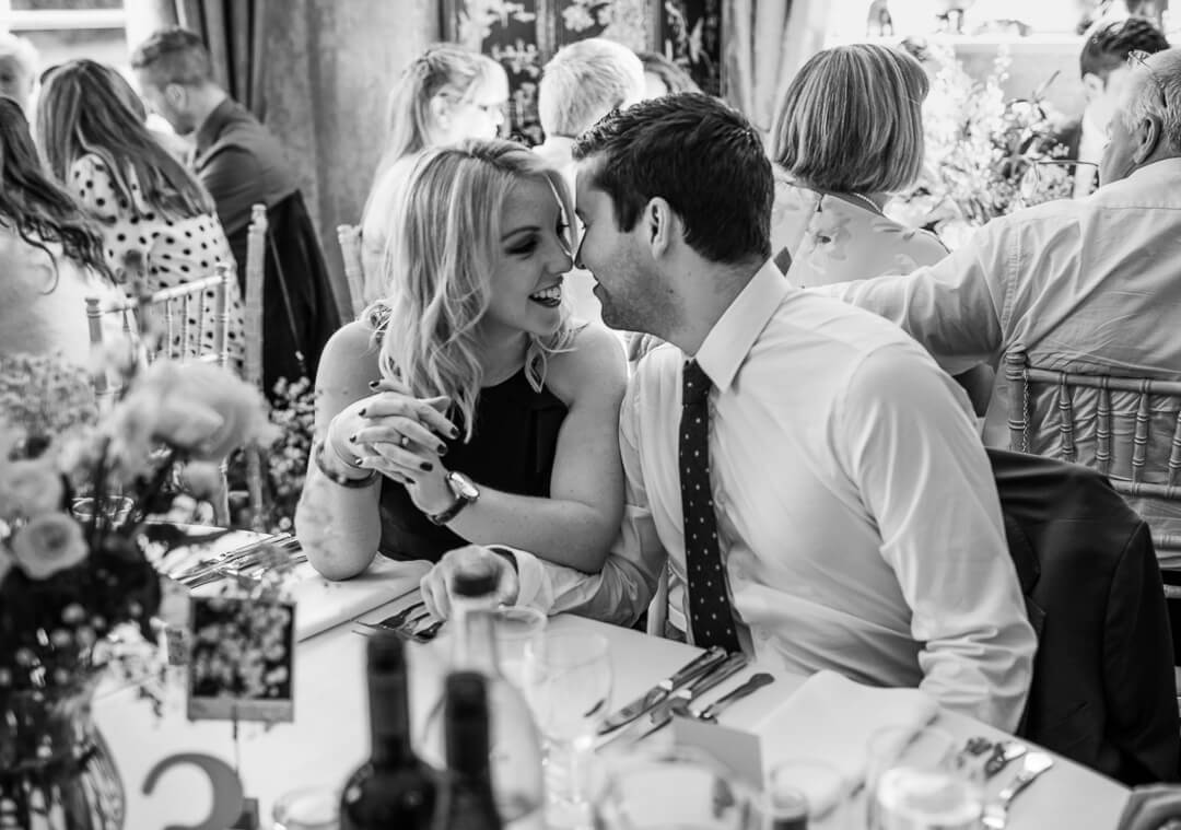 Guests getting intimate at wedding breakfast