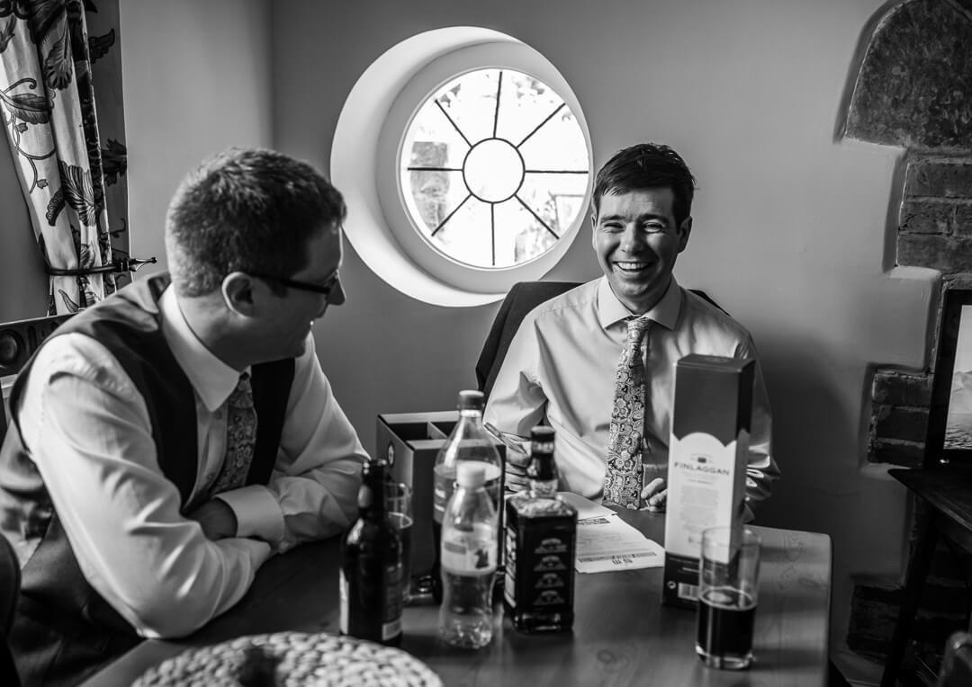 Best man laughing at wedding preparations
