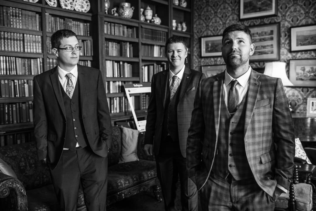 Groomsmen waiting in library at Homme House wedding