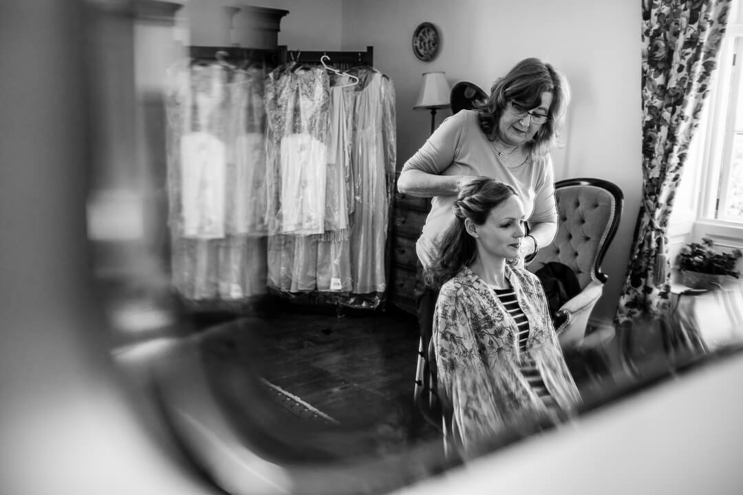Bridesmaid getting ready at wedding