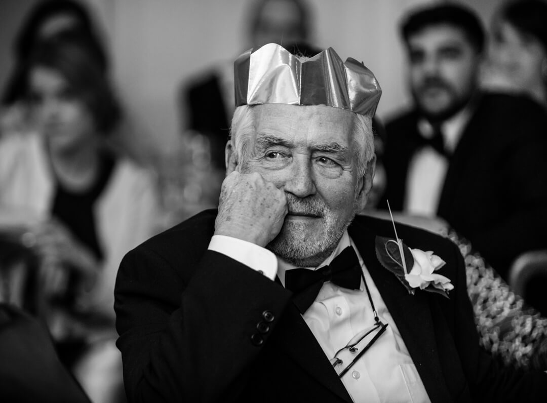 Grandad listening to the speeches at a Winter Welsh Wedding