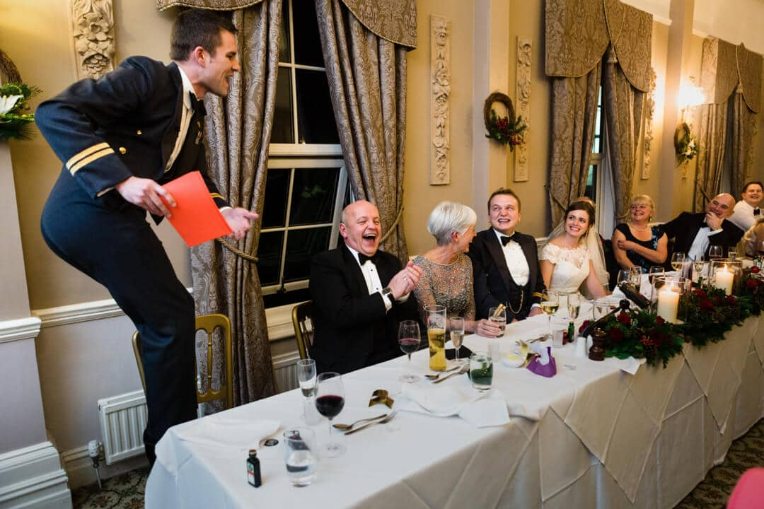 Best man getting up to antics during speeches at Winter Welsh Wedding