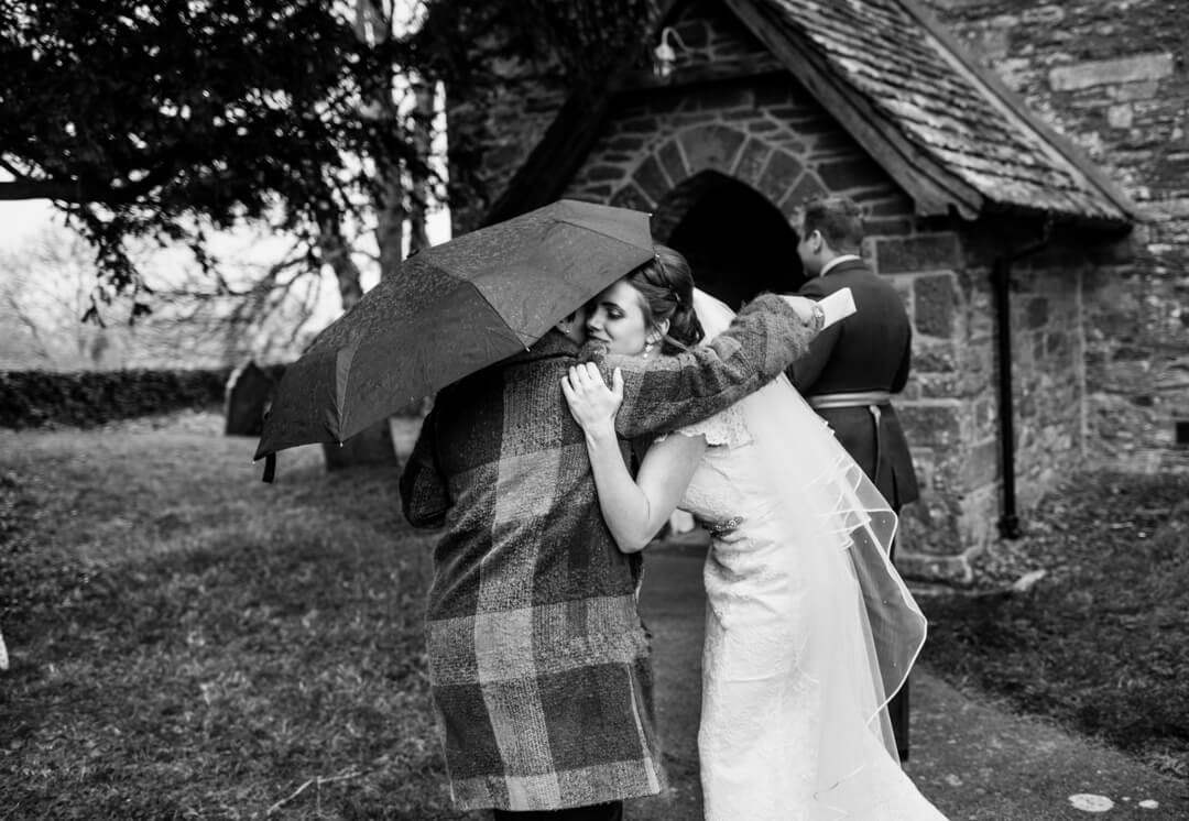 Bride hugging wedding guest after ceremony