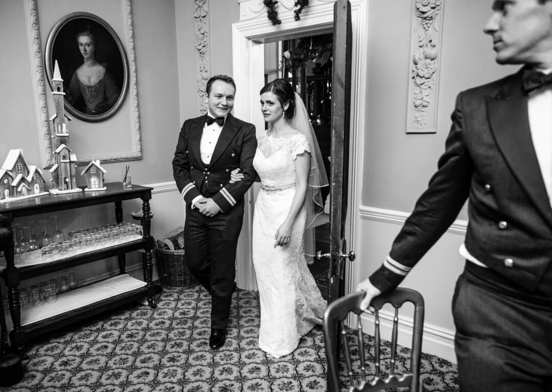 Bride and groom entering dining room