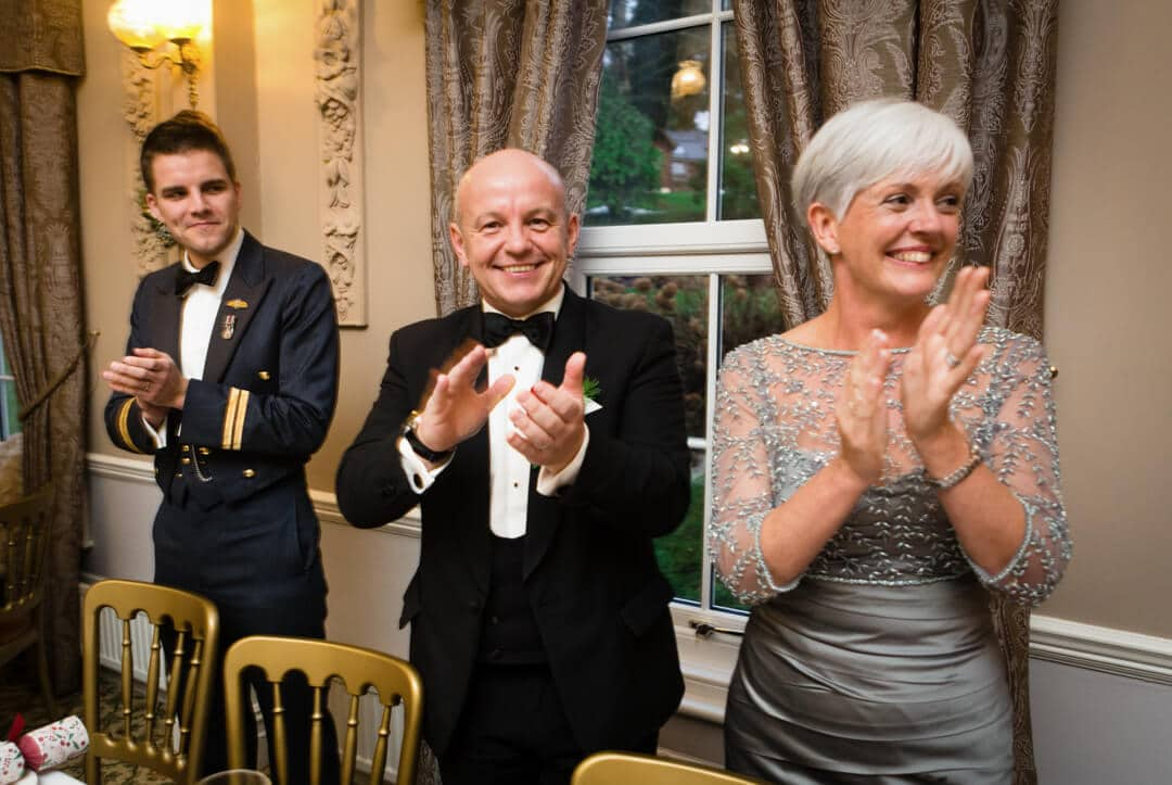 Wedding guests cheering as bride and groom make an entrance