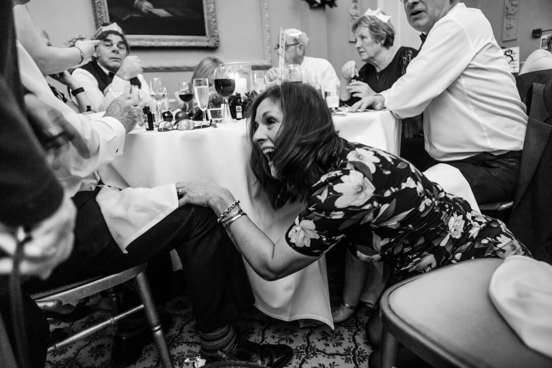 Wedding guest fooling around under the table