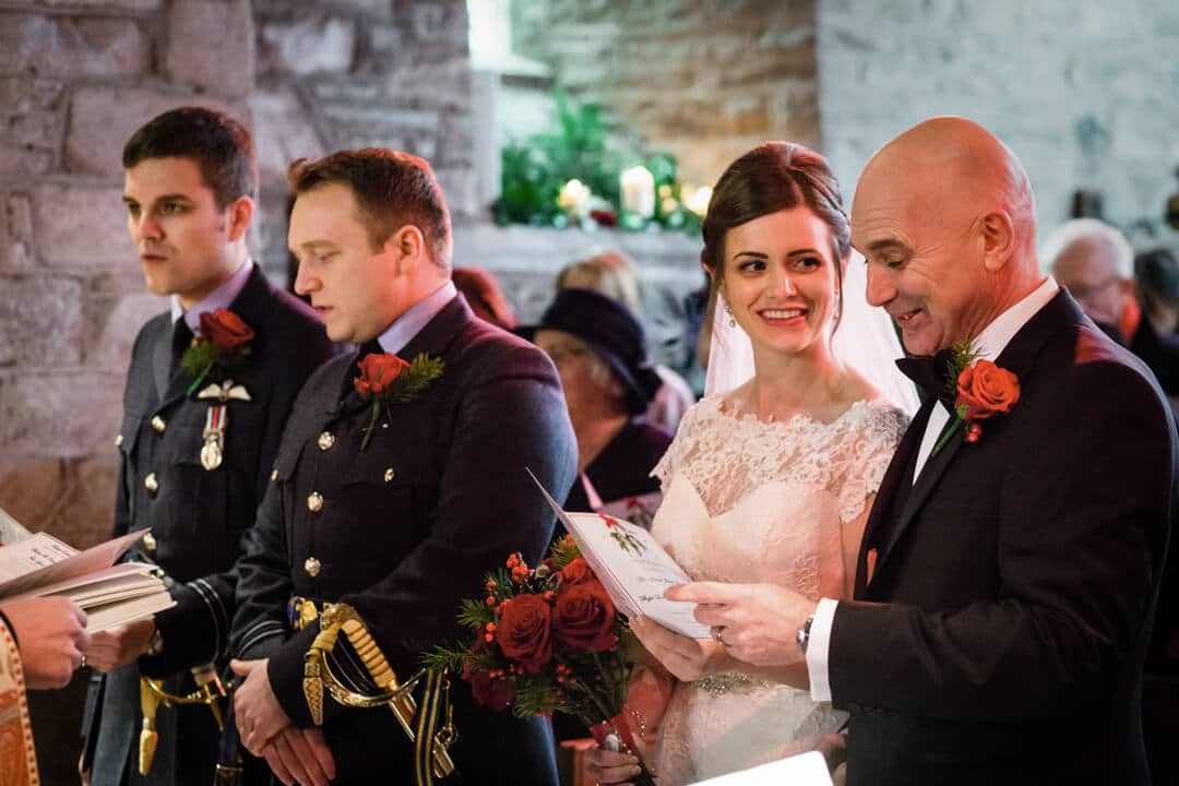 Bride looking at her father at winter Welsh wedding