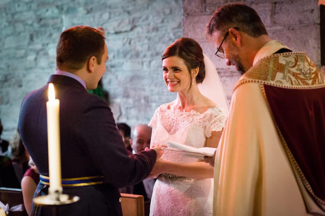Bride and groom exchanging vows at Winter wedding