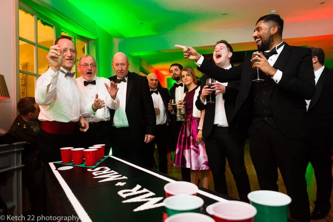 Guests playing ping pong games at The Lake Hotel wedding