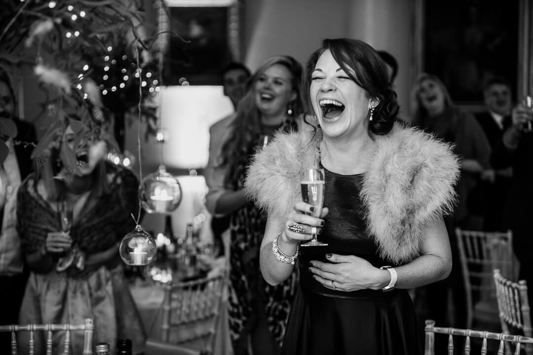 Wedding guest laughing at speeches in Herefordshire