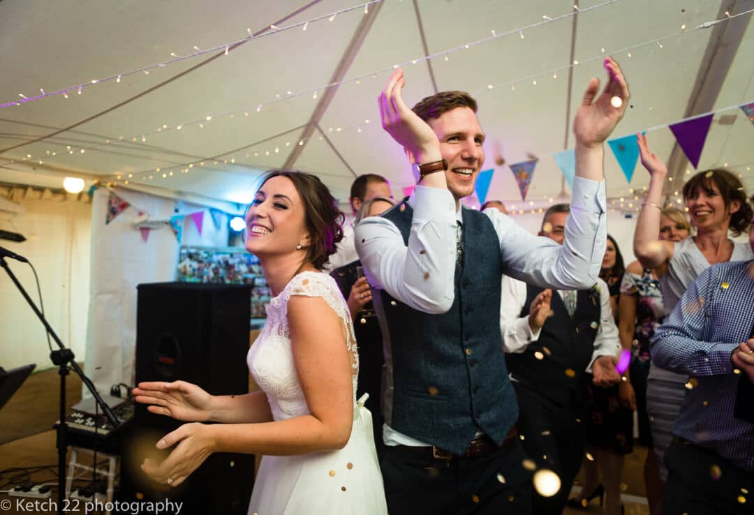 Bride and groom clapping at first dance for Marquee wedding
