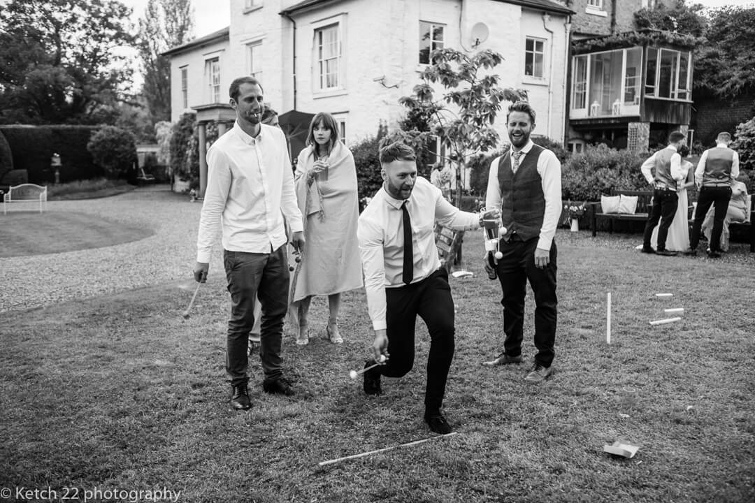 Guests play wedding lawn games