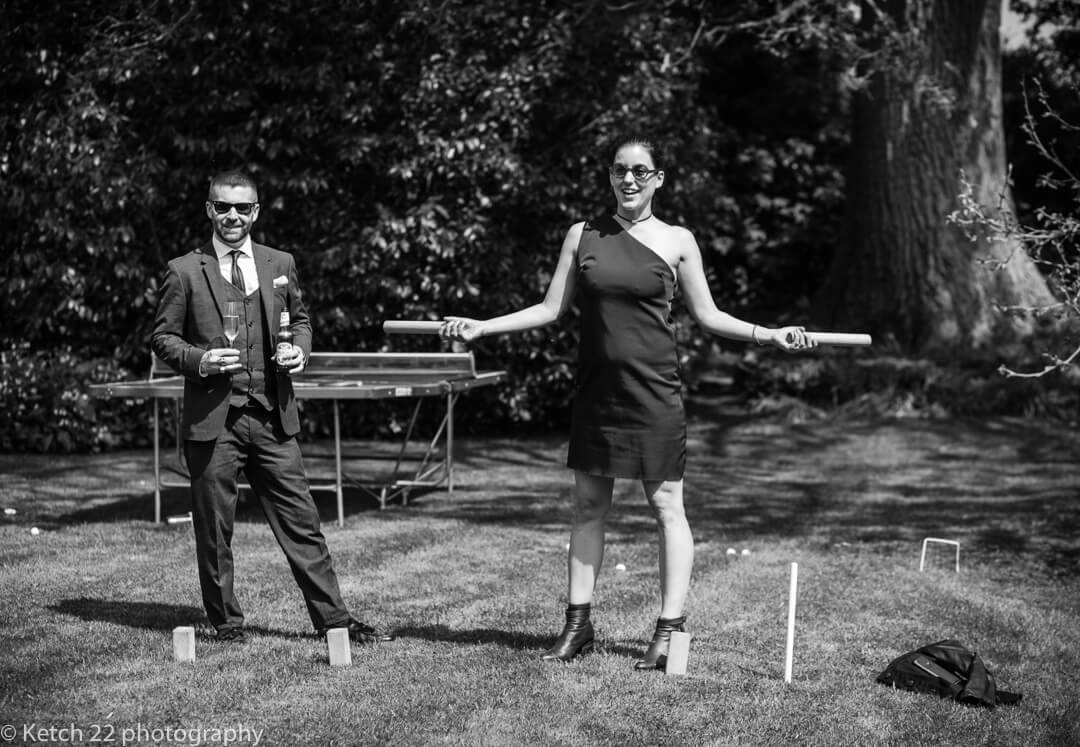 Wedding guests playing lawn games