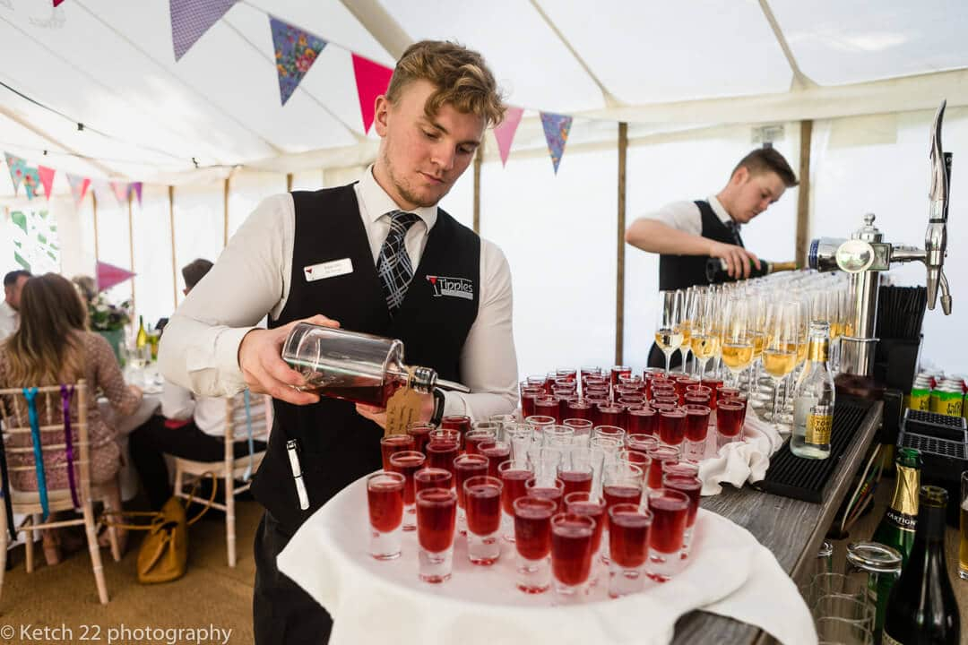 Barman pouring drinks at Herefordshire wedding