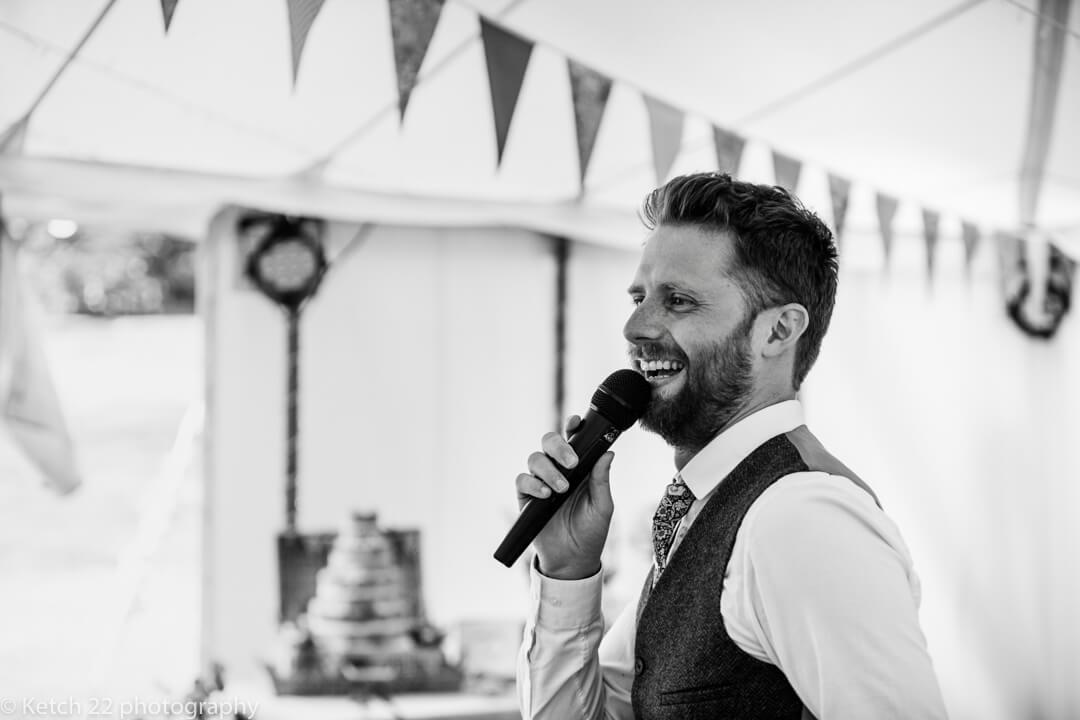 Toastmaster speaking at wedding