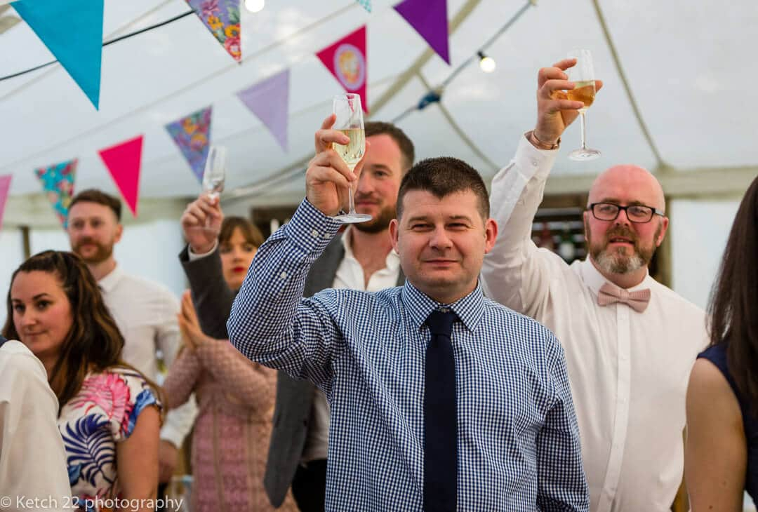 Wedding guests toasting