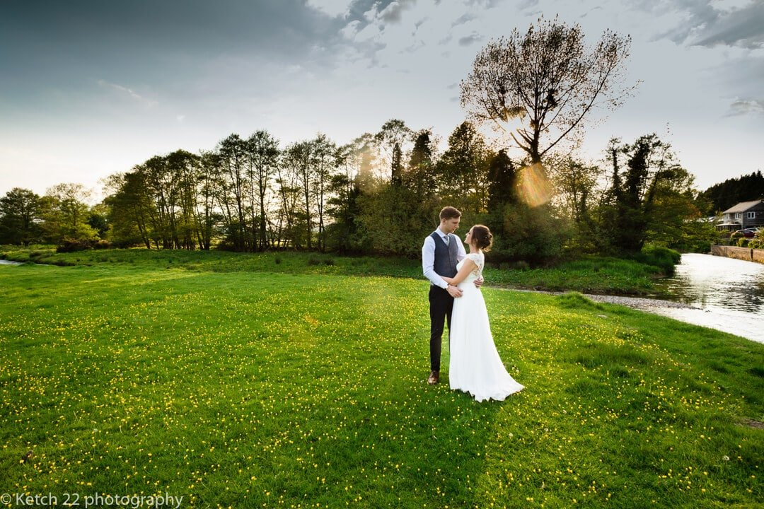 Sunset photo of bride and groom in feild