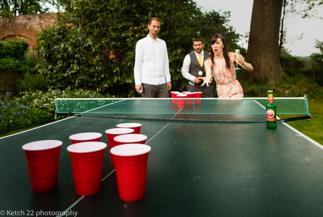 Playing ping pong in the garden at wedding