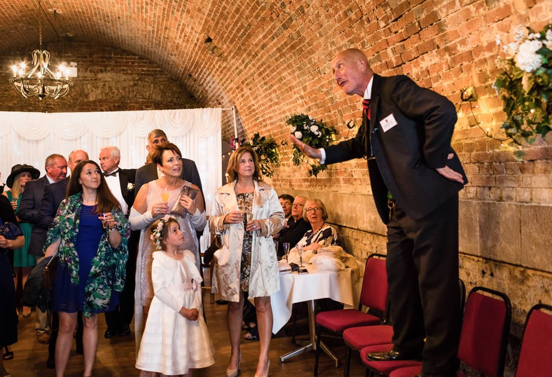 Wedding guests listening to host
