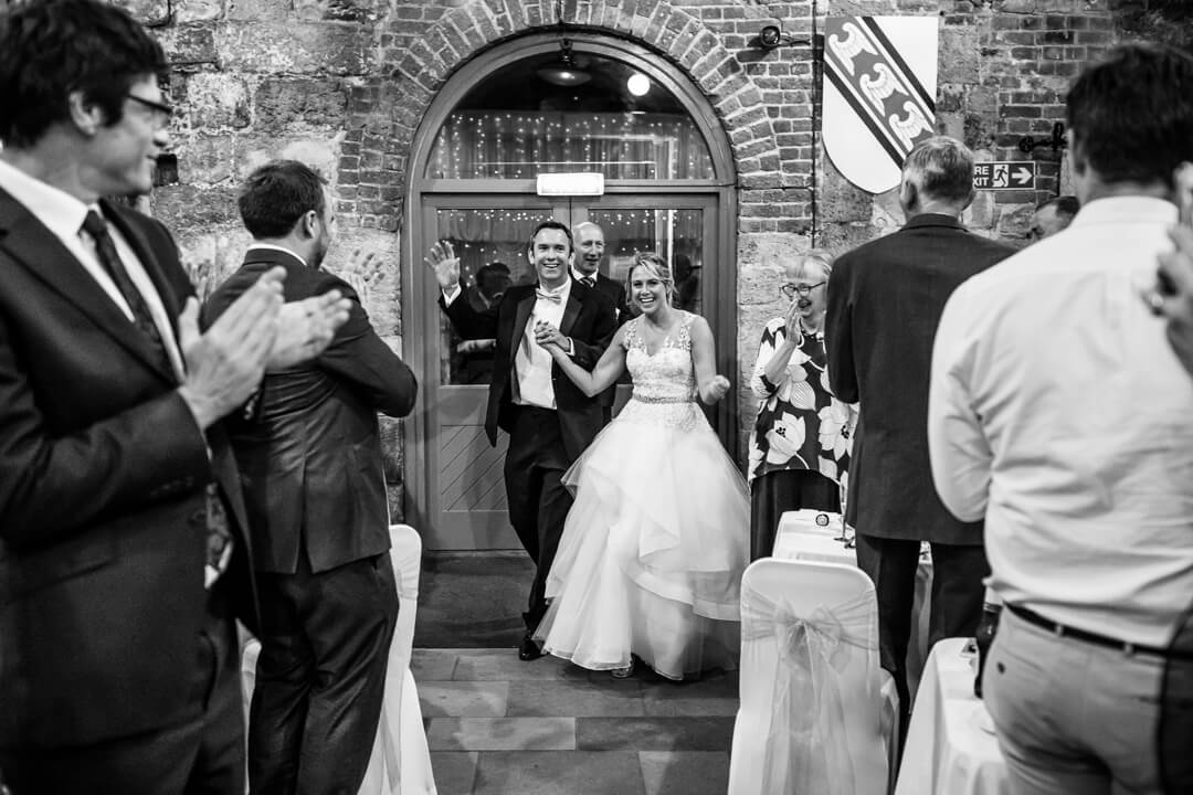 Bride and groom making an entrance at The square Tower Wedding Portsmouth