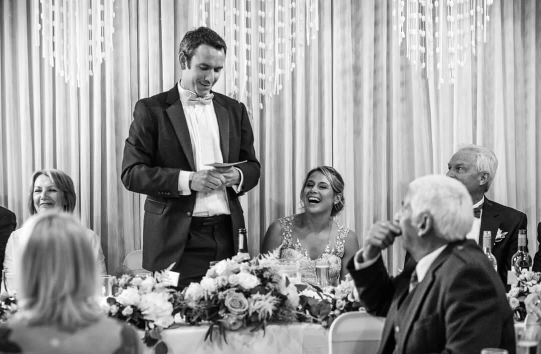 Documentary wedding photo of groom making speech
