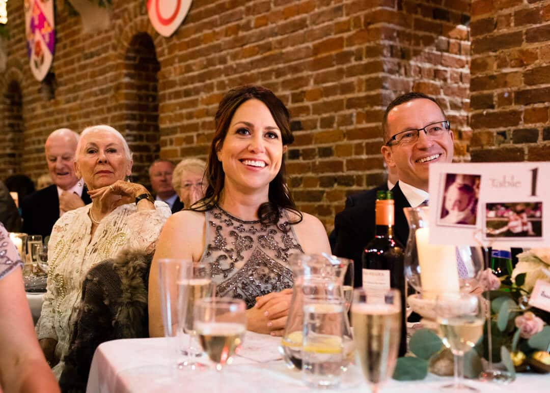 Bridesmaid reacting to speeches at Portsmouth wedding