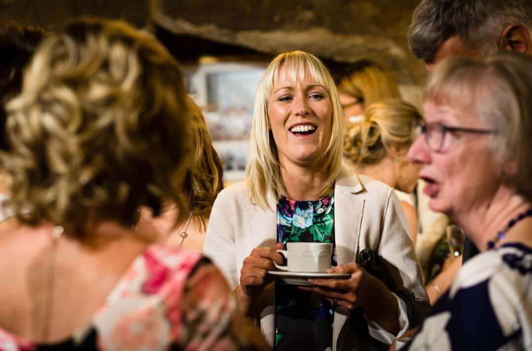 Wedding guest drinking coffee and chatting