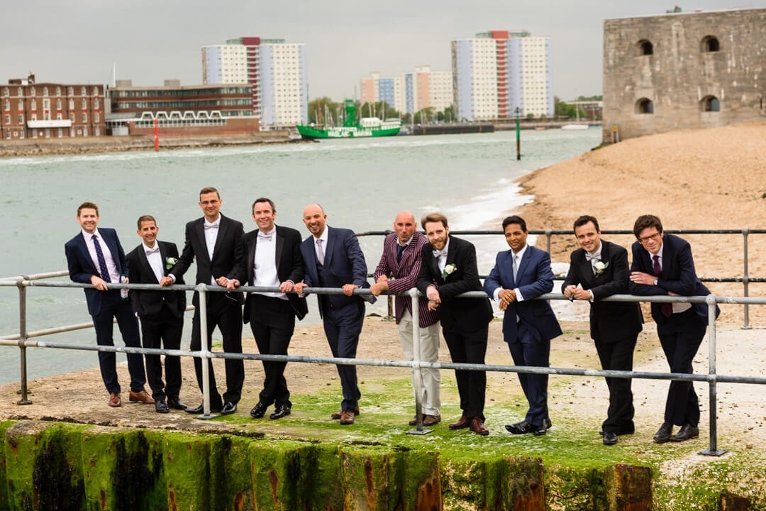 Groom and Ushers on sea pier at The Square Tower Wedding portsmouth