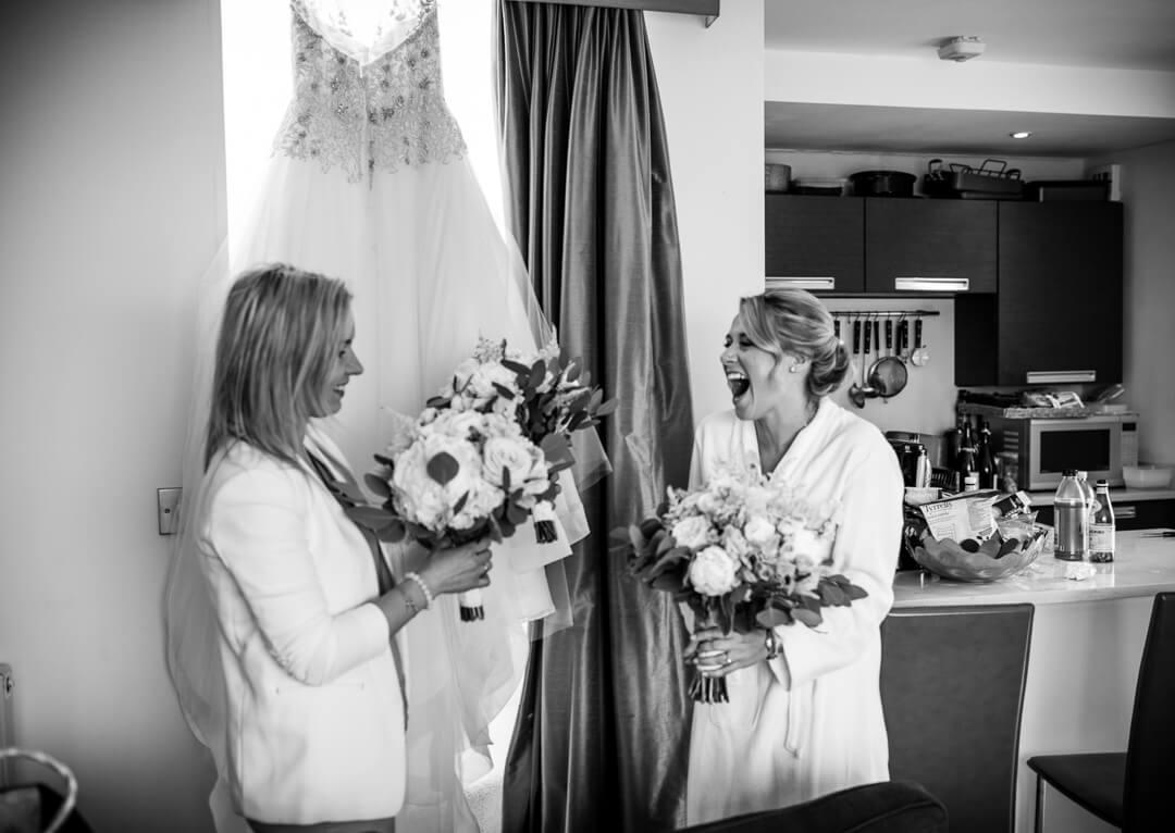 Bride receiving flowers at wedding prep