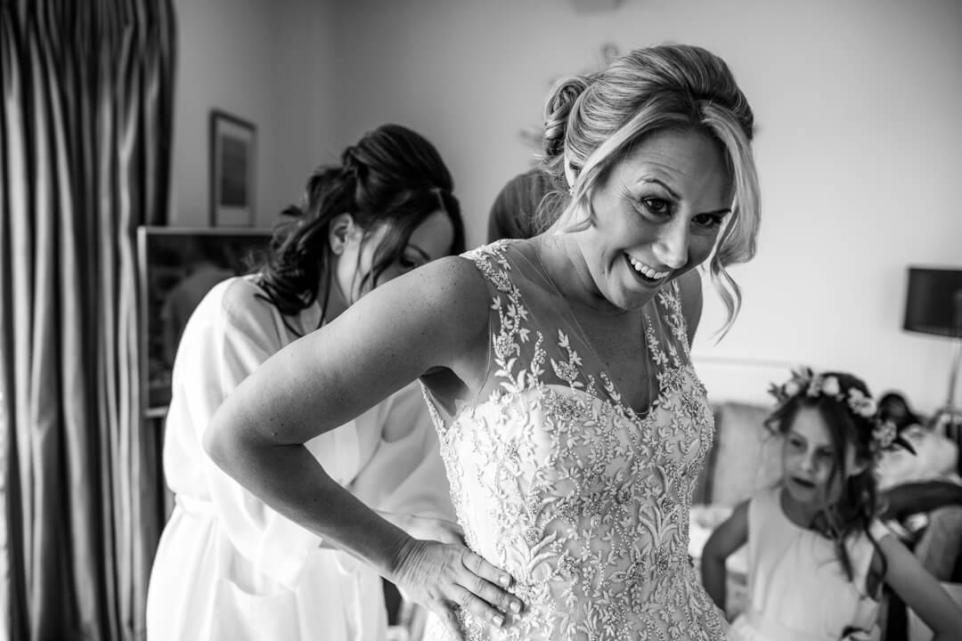 Bride putting wedding dress