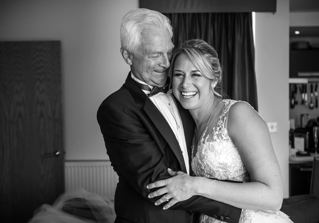 Bride and father hugging at Wedding preparations