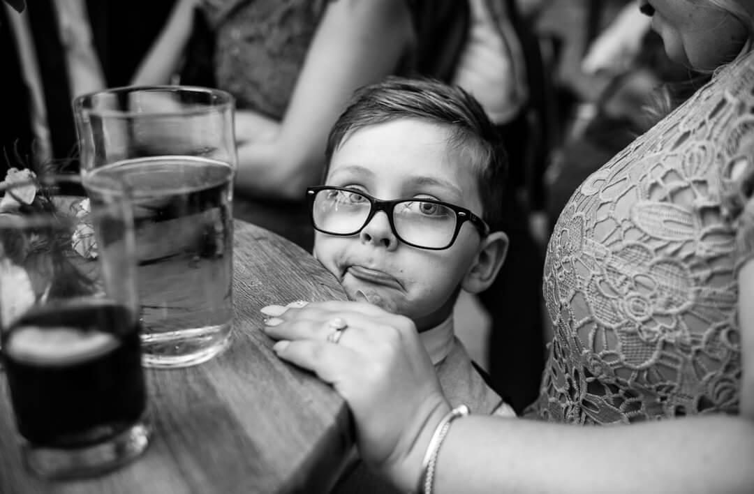 Page boy making strange face at Kingscote Barn Wedding