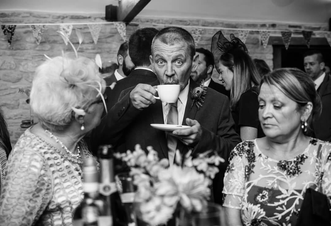 Wedding guest enjoying a cup of tea