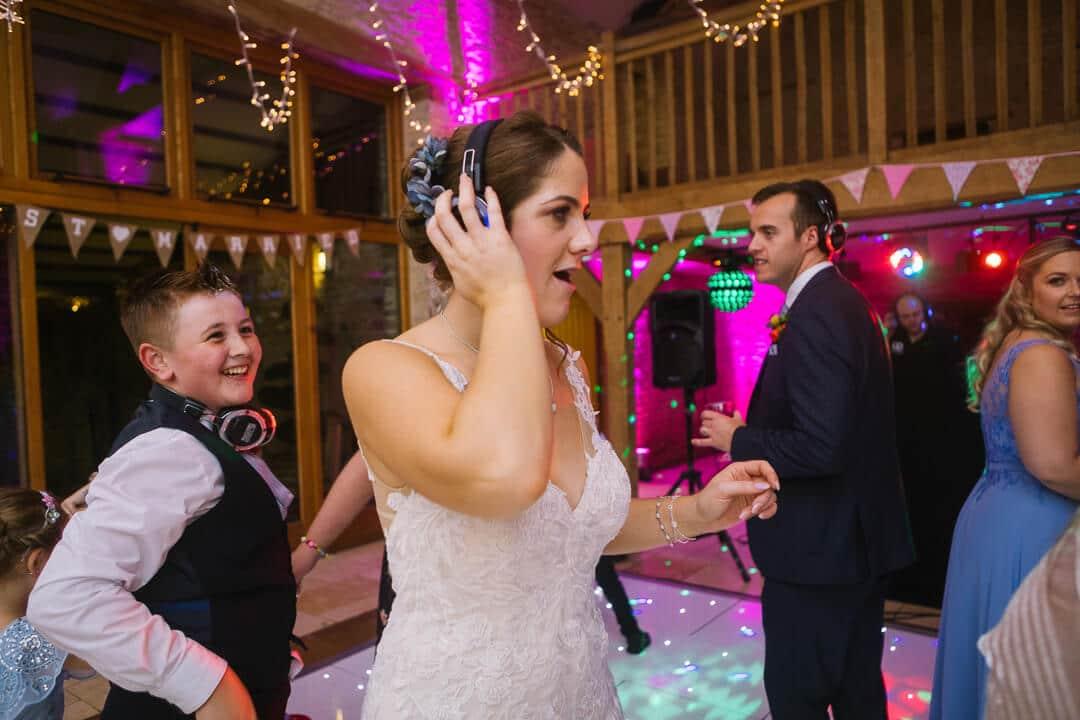 Bride dancing at Cotswold wedding