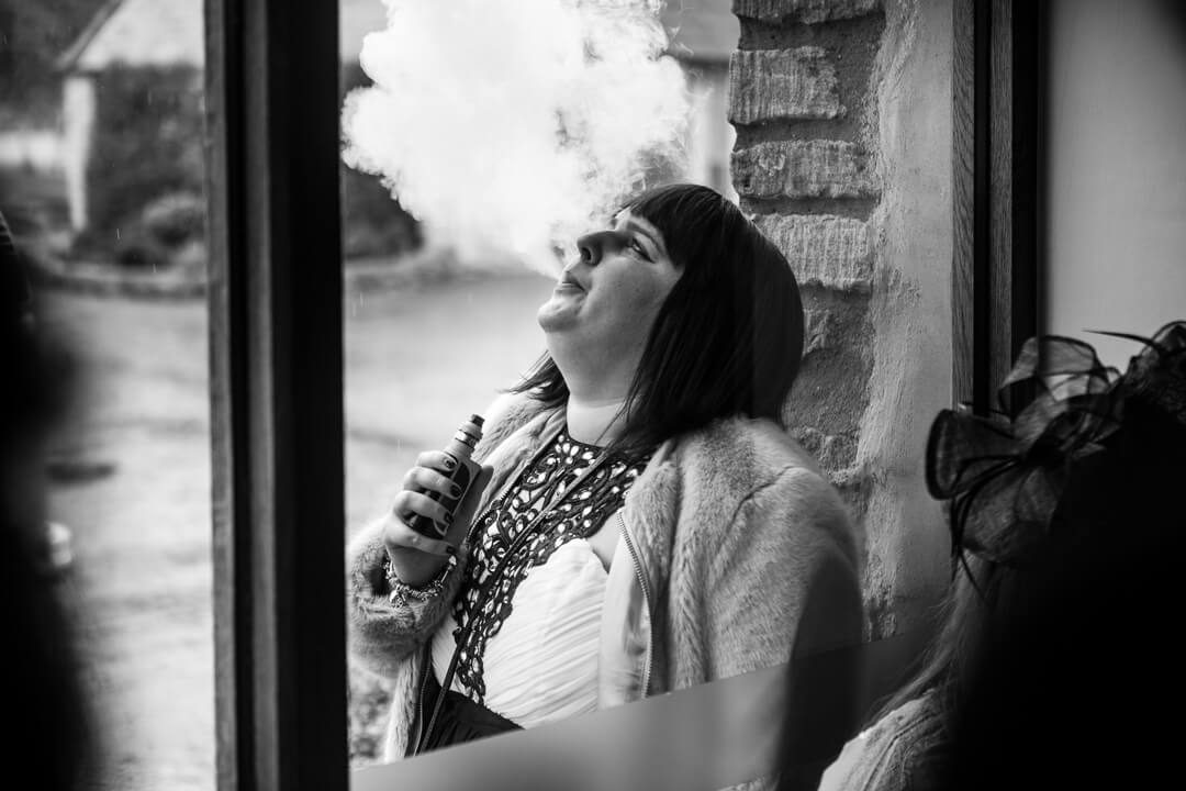 Wedding guest vaping in Gloucestershire