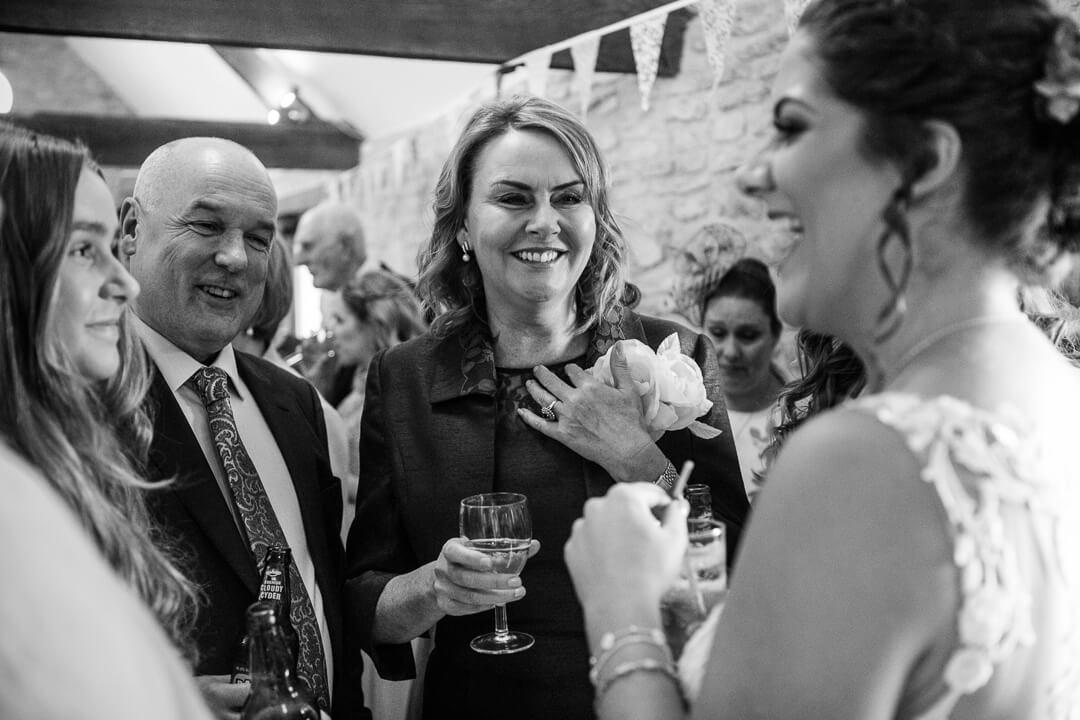 Wedding guests talking to bride at reception