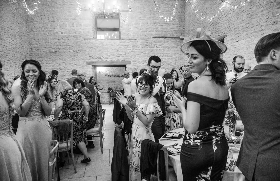Wedding guests welcoming bride and groom at reception