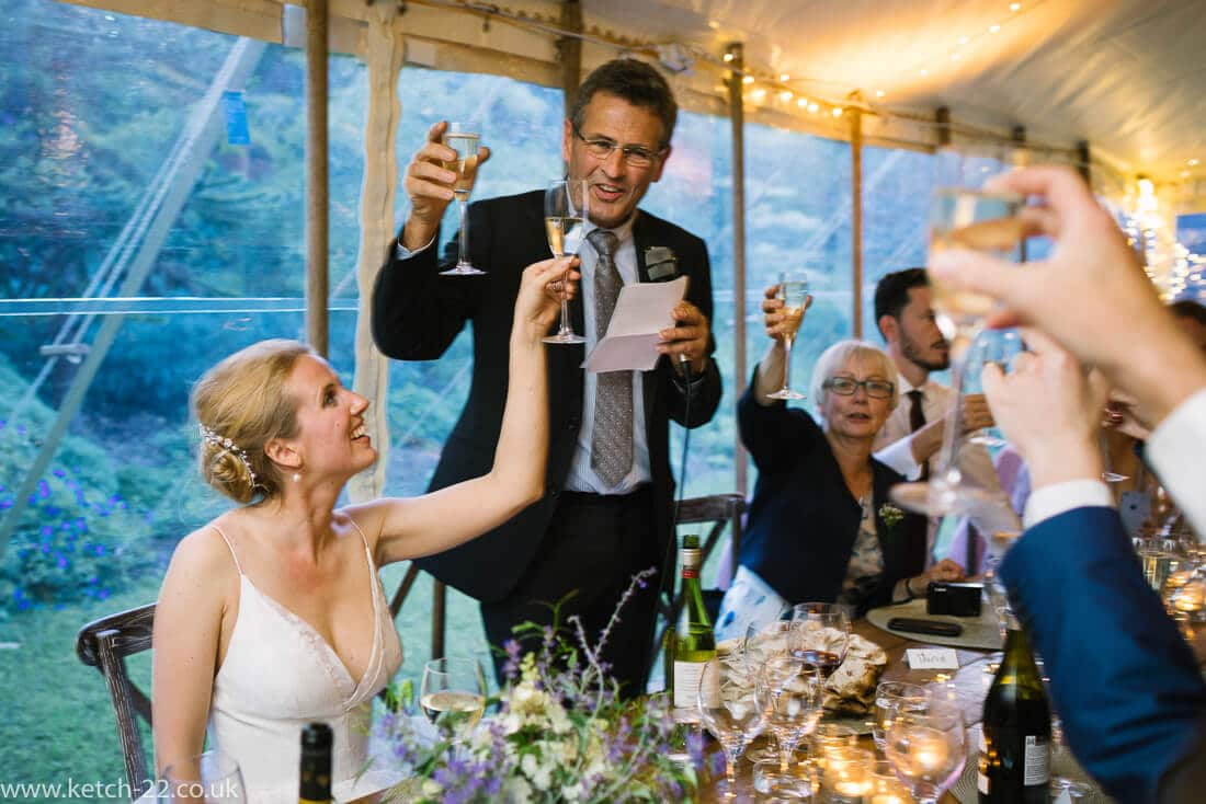 Bride and father toasting at wedding speeches