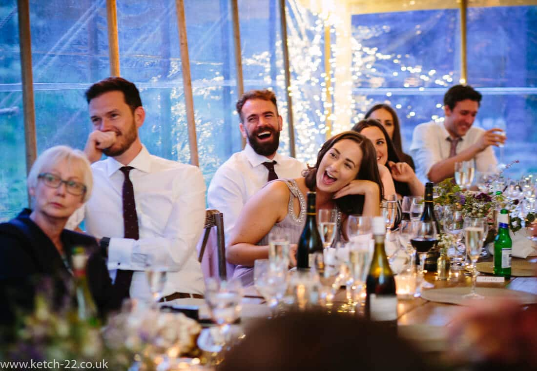 Guests in wedding marquee listening to speeches