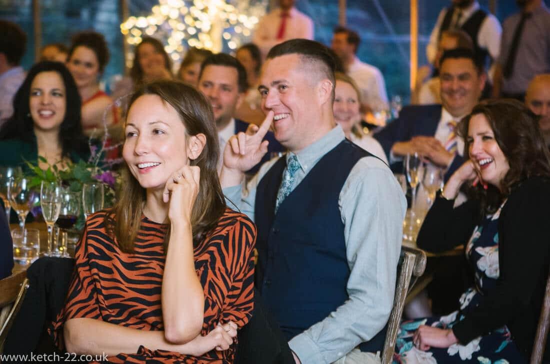 Guests listening to wedding speech