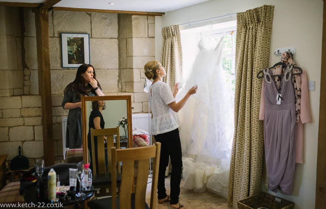 Bride inspecting her wedding dress
