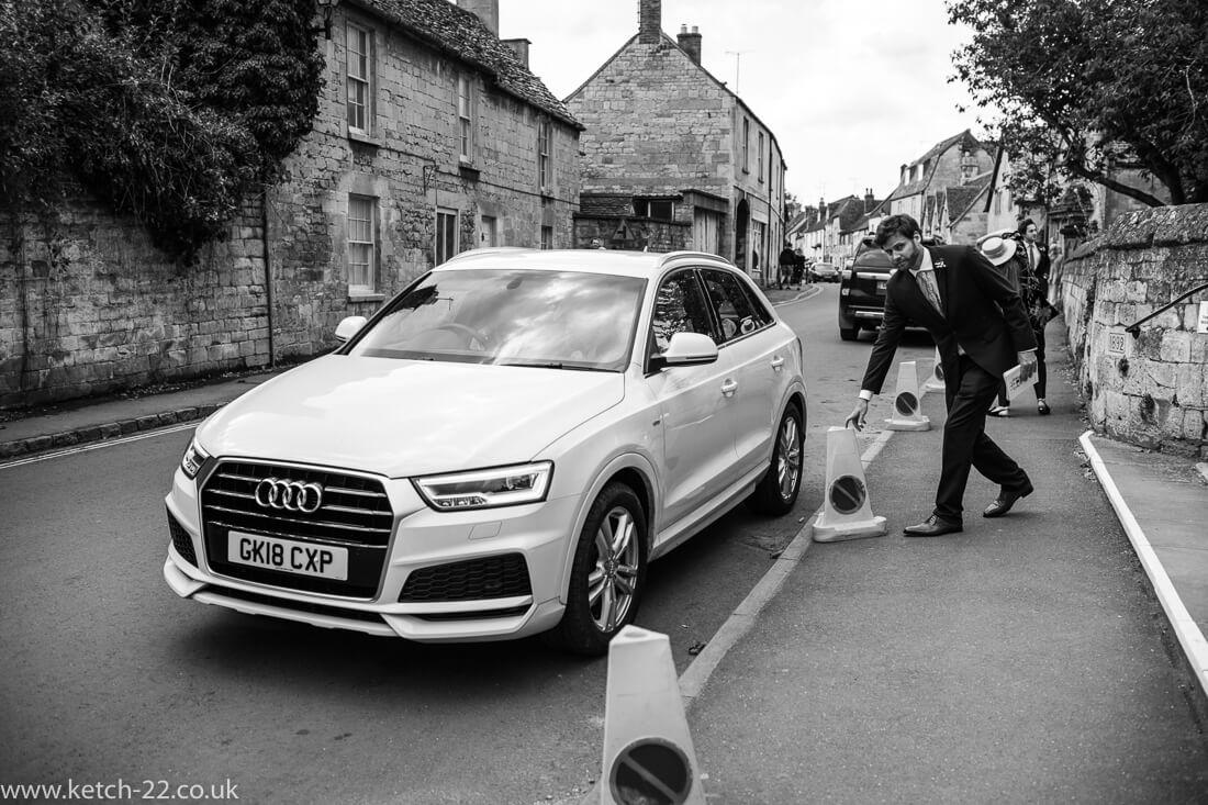 Bride arriving in white audi car