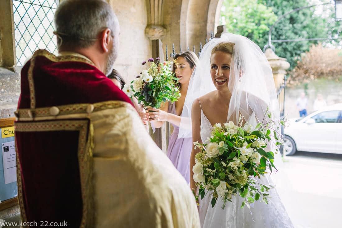 Bride talking to vicar before wedding ceremony