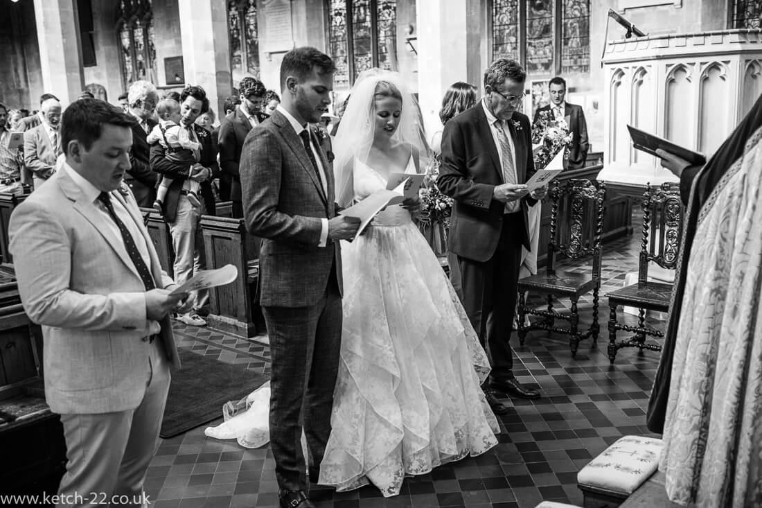 Bride and groom singing at church wedding