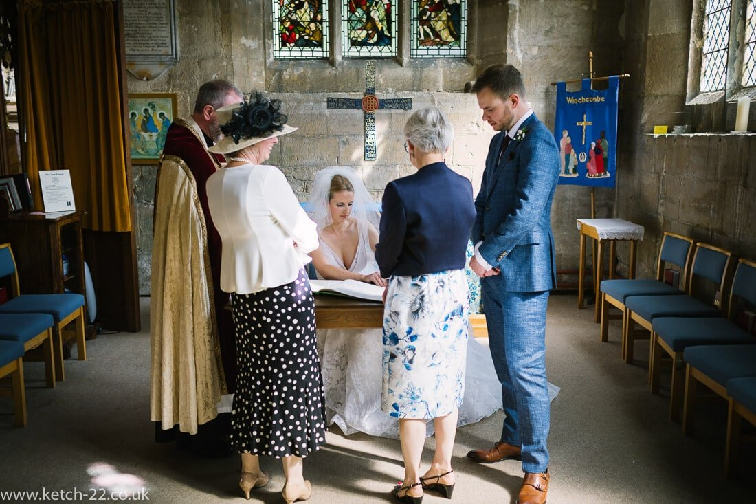 Bride signing registrar at Church wedding