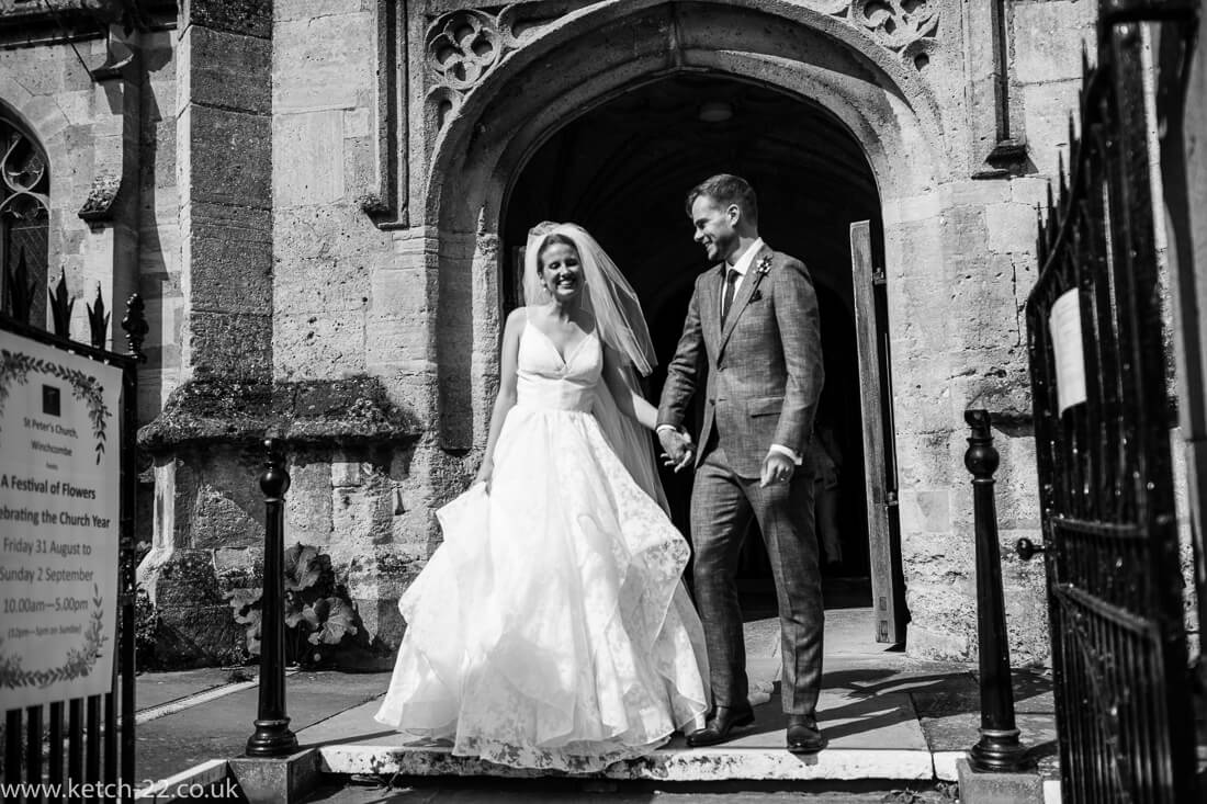 Bride and groom outside church after wedding ceremony