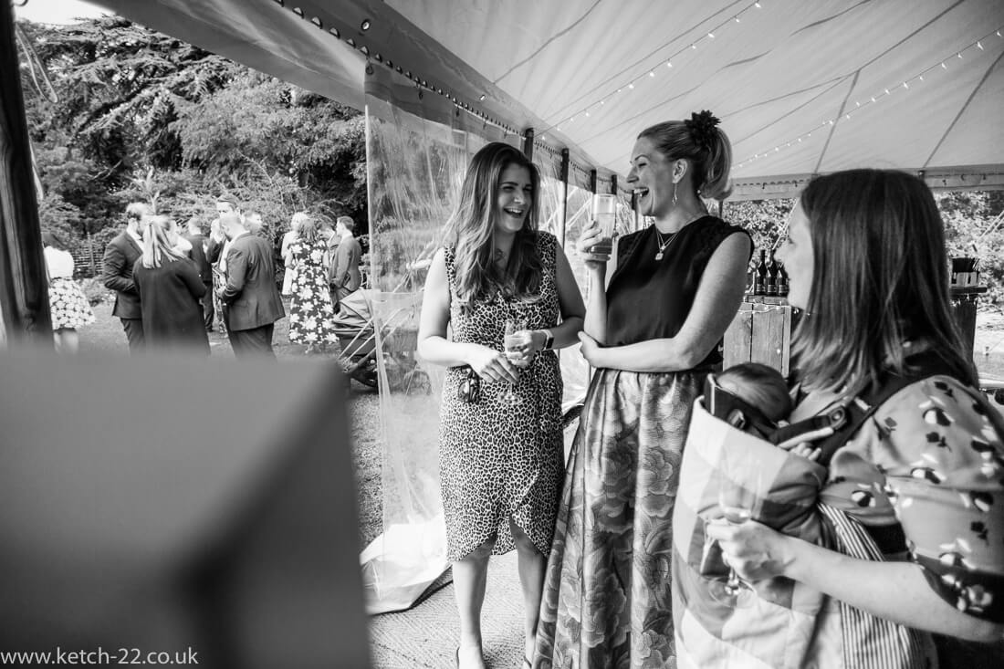 Wedding guests laughing at reception